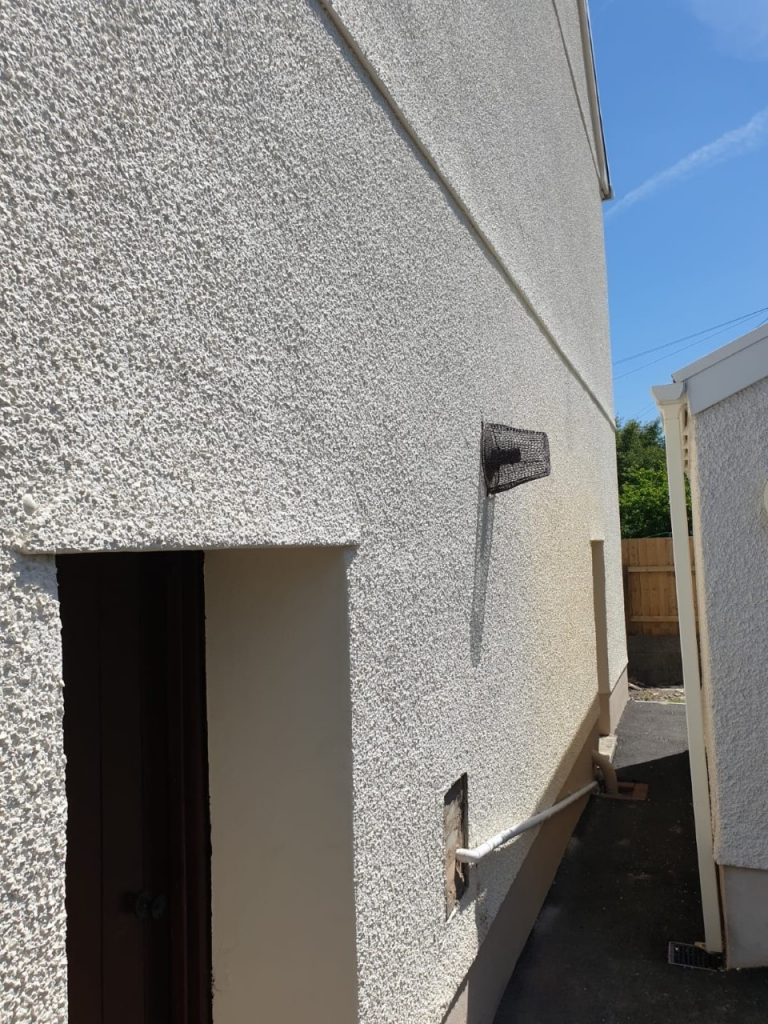 Rear side view of Exterior wall painted by Painting Specialists Swansea