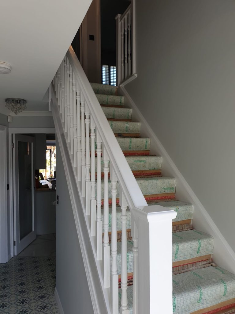 Close up view of staircase painted white by Premier Swansea painters and decorators in property in Llansamlet, Swansea