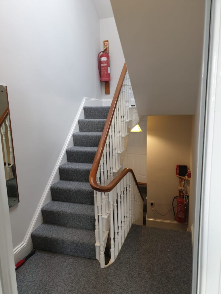 Interior House Painting on first floor stairs and landing of student property in Swansea